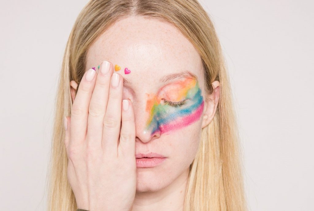 Woman with Rainbow Make Up | Breast Cancer Car Donations