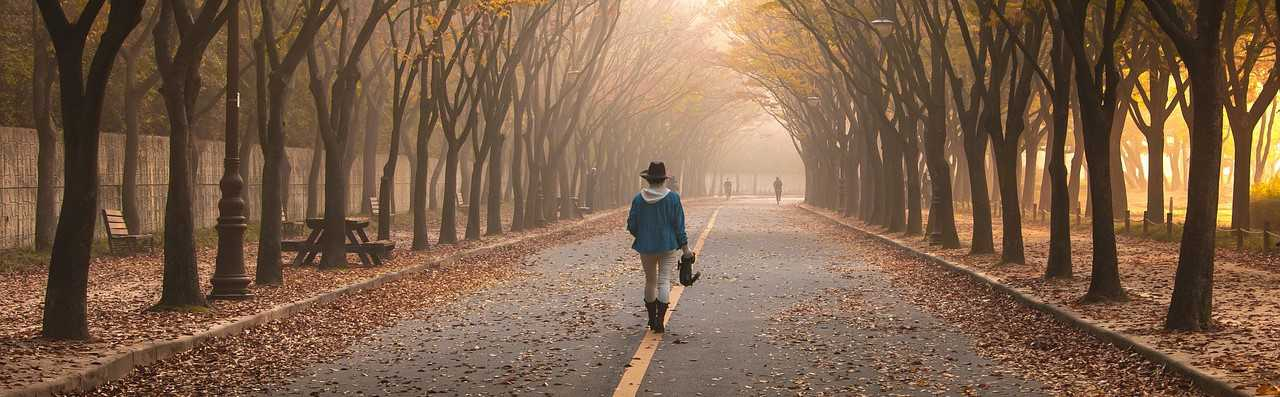Woman Walking in Foliage | Breast Cancer Car Donations