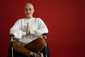 Woman on Wheelchair Meditating | Breast Cancer Car Donations